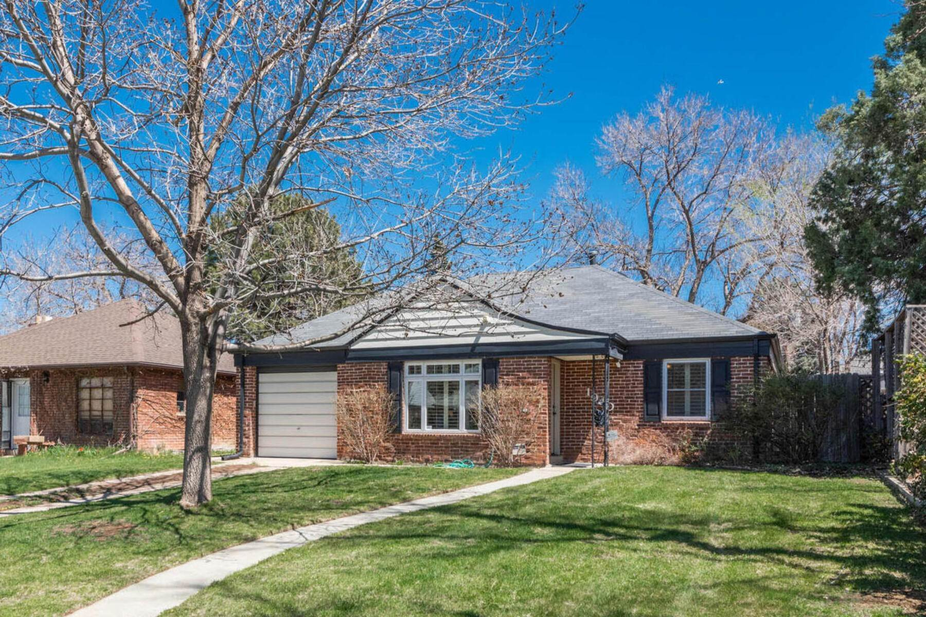 Single Family Homes for Sale at Sun-Filled Ranch in University Park 1940 S Clayton Street Denver, Colorado 80210 United States