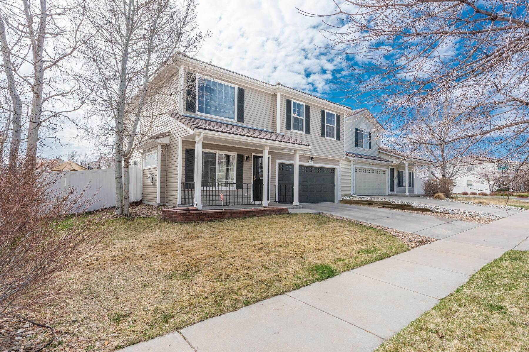 Single Family Homes for Sale at Gorgeous & Extremely Well Maintained Green Valley Home! 4982 Fundy Street Denver, Colorado 80249 United States